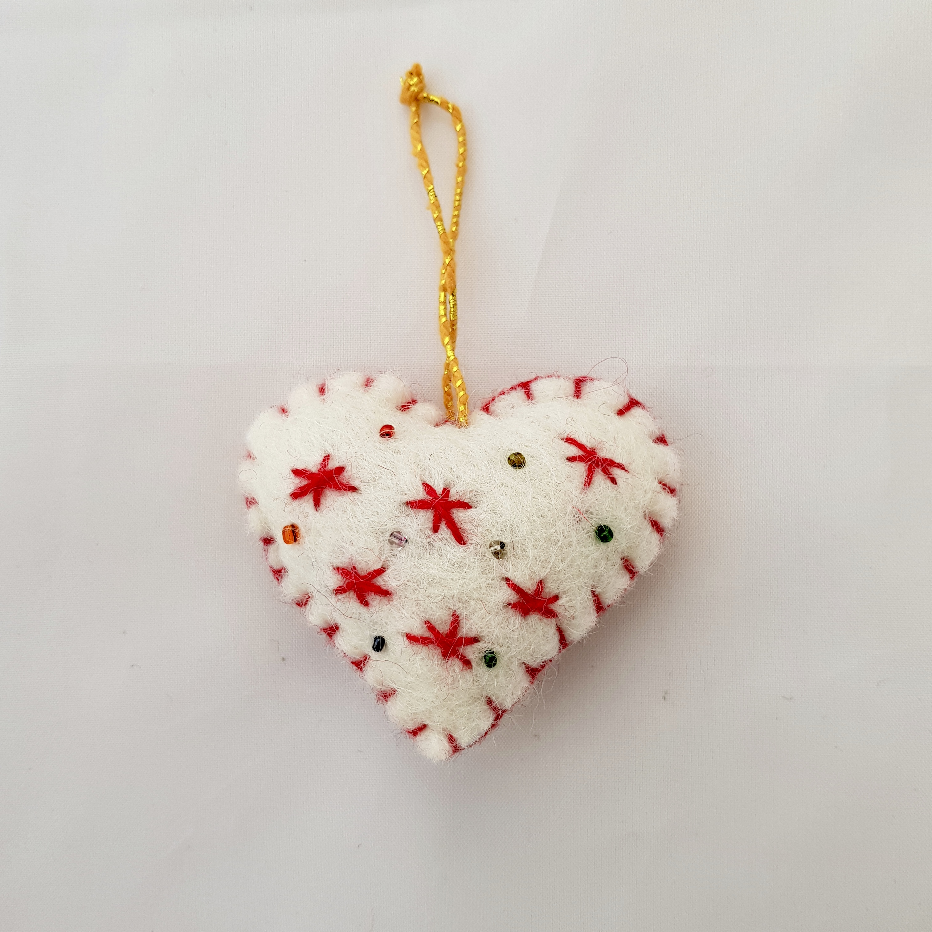 White and red heart tree hanging.