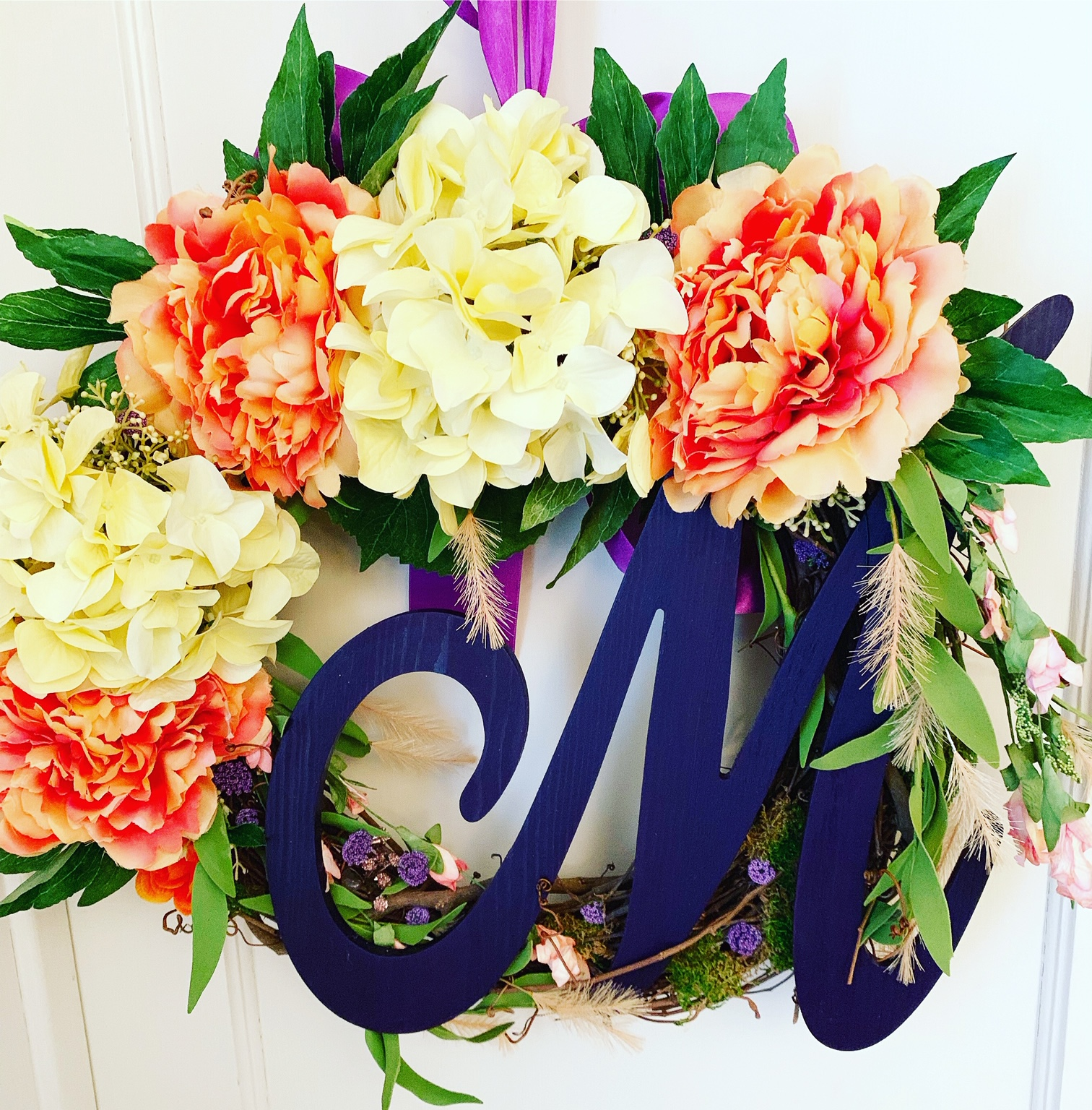 orange and yellow wreath with purple let