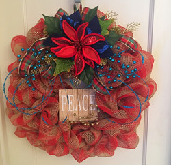 Large peace sign and floral wreath