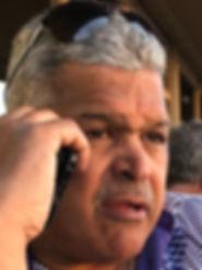 Felton on Phone Headshot.jpg