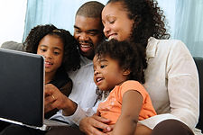 african-american-family-around-computer.
