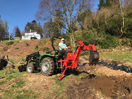 40hp working hard with back hoe and loader