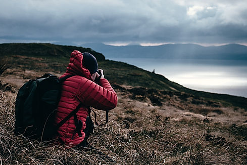 Young outdoorsman photographing Flathead Lake in Montana