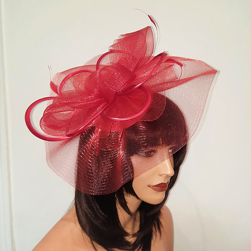 Red Crin Fascinator with satin loopsmounted on to a band 100621