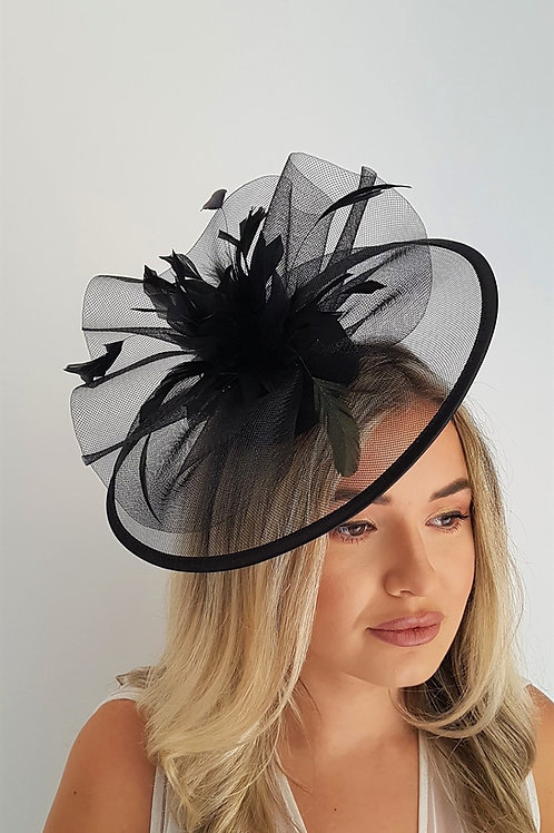 Black Crin Fascinator Hat trimmed with satin on a band