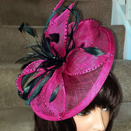 Fuschia Pink & Black sinamay fascinator on a band, worn to the side of the head