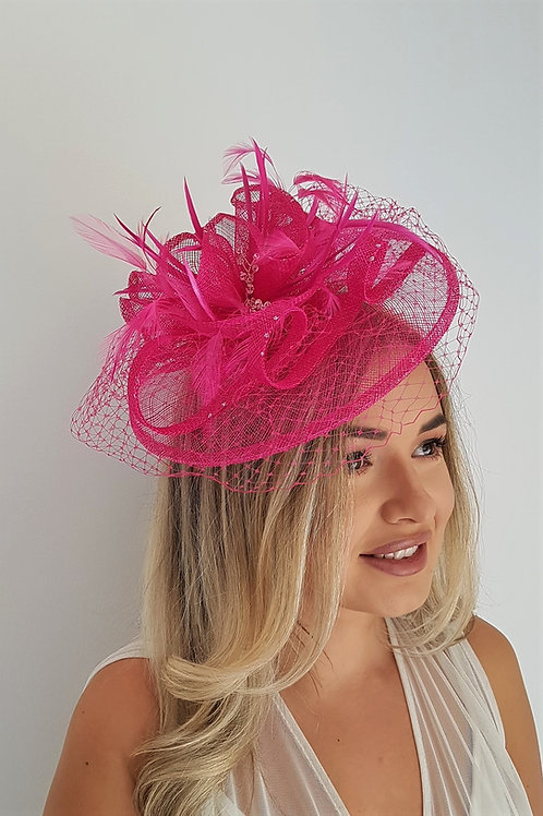 Pink Fascinator Hatinator with veiling & crystals on a band