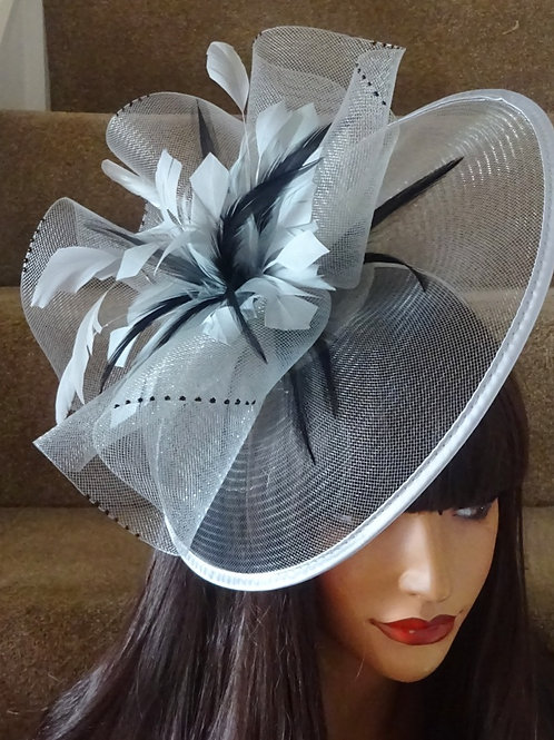 Silver & Black Fascinator mounted on to a band 123477