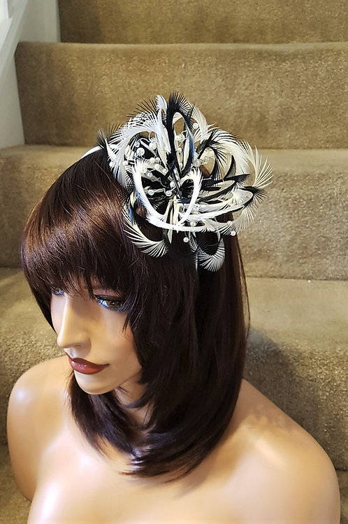 Black and white looped fascinator with pearl beading on a silver plastic band