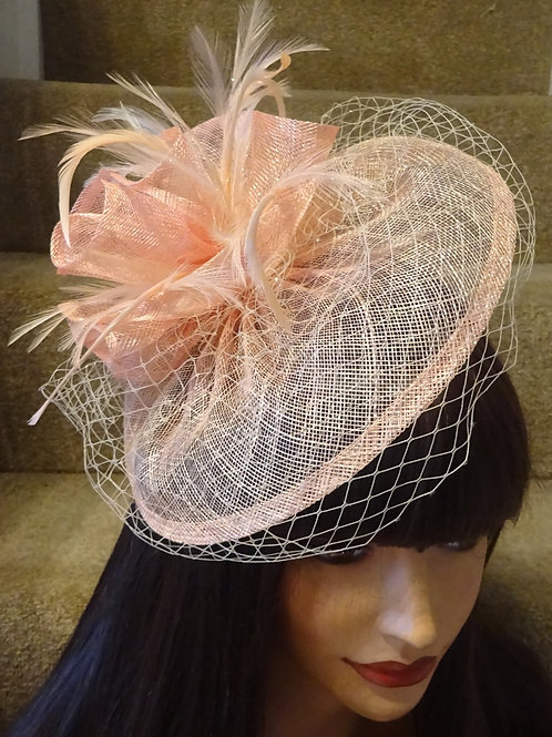Pale Peach Blush Fascinator Hat on band with veiling 12349