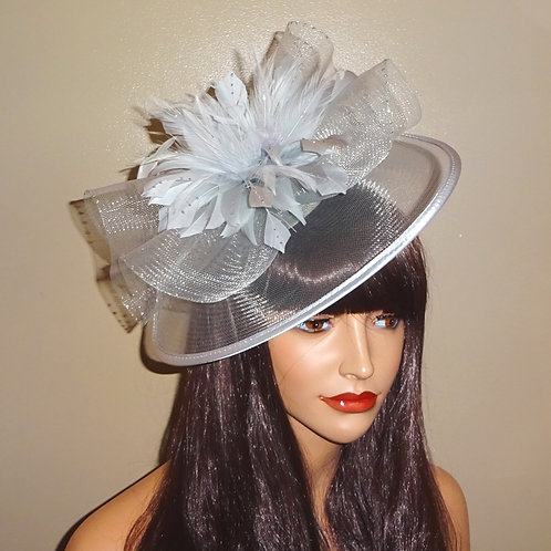 Light Silver Fascinator with a touch of sparkle trimmed with ribbon
