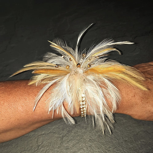 Shades of gold feathers with gold crystals on an elasticated diamante band