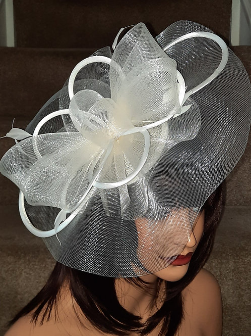 Ivory Crin Fascinator Hat with satin loopsmounted on to a band 100621