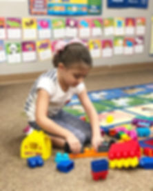 child playing at prek at stepping stones