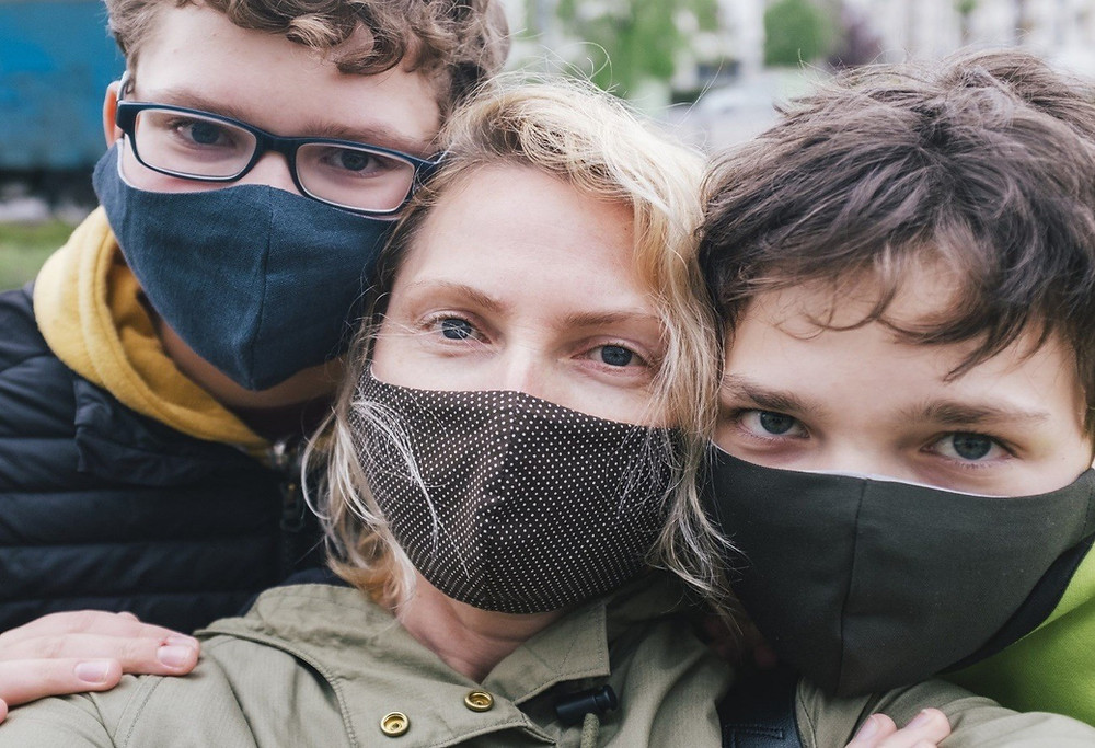 Mother and children take a photograph with protective masks during the coronavirus pandemic (ARTindividual / Getty Images)