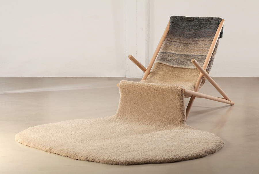 Artist Alexandra Kehayoglou's rug faking sand on the beach