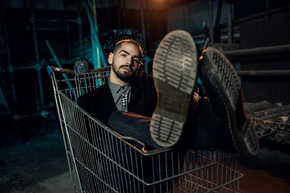 Dancer Mattia tuzzolino sitting in a cart