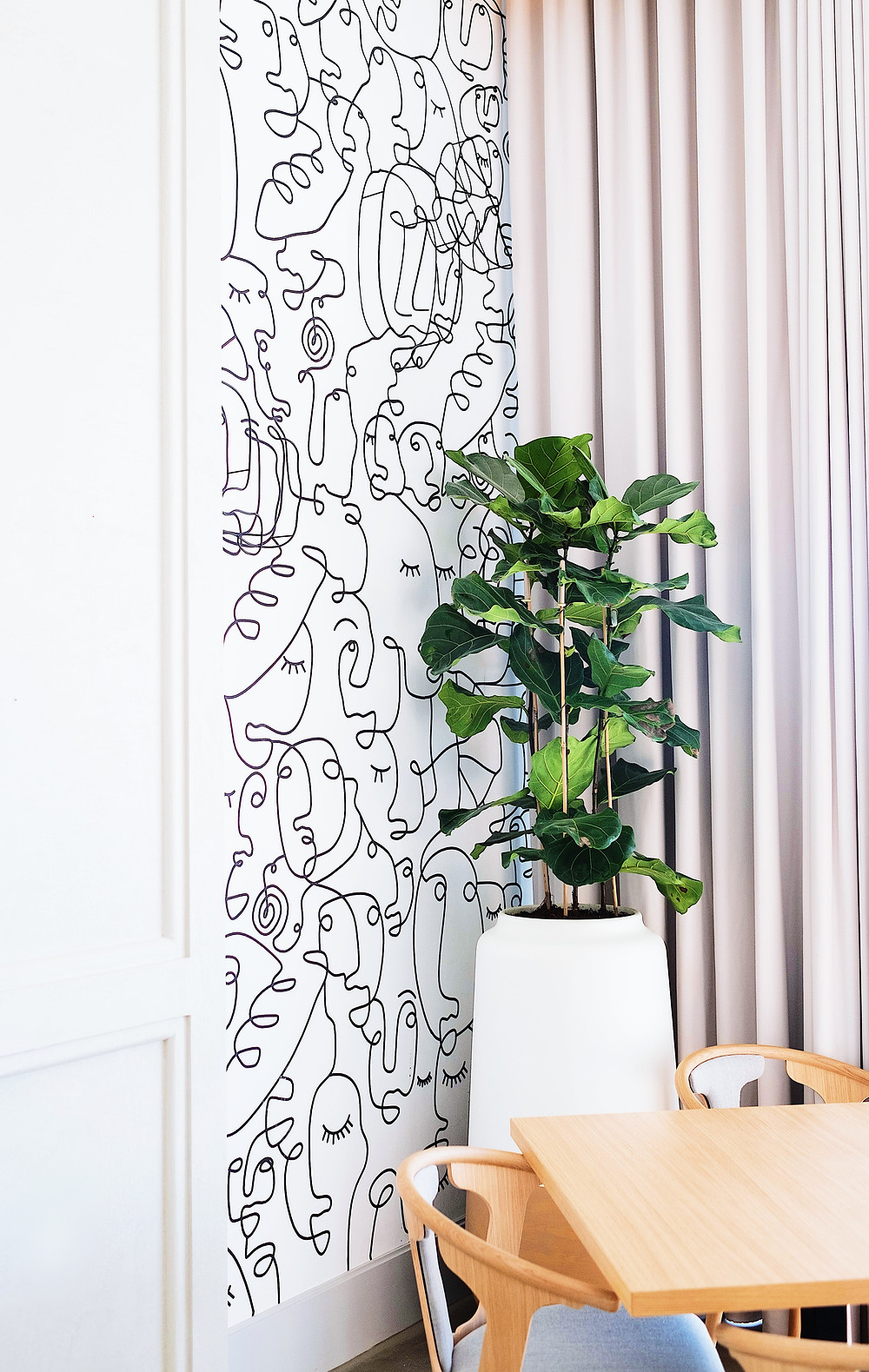 Interior designer Lourdy Ghorayeb's stylized artwork on a house wall