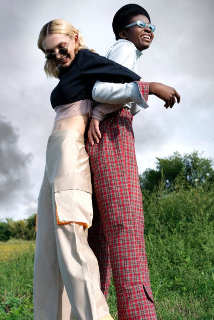 Two women dressed in typical Herero fashion style hugging