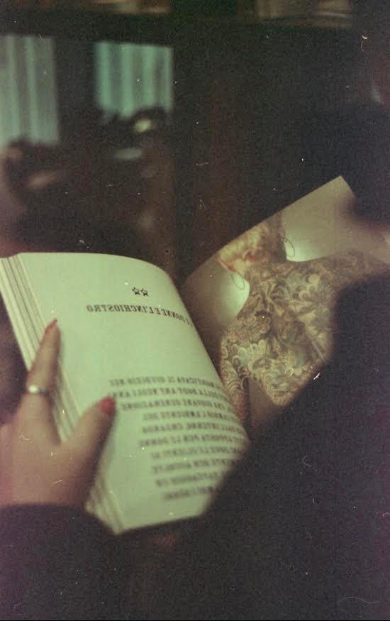 Photographer Laura Munari's shoot of an open book about tatoos
