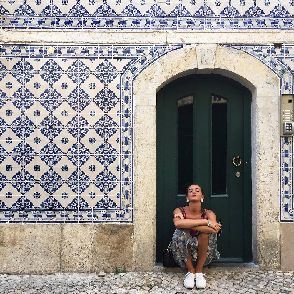 emergent designer Simona De Fazio under a wall mosaic