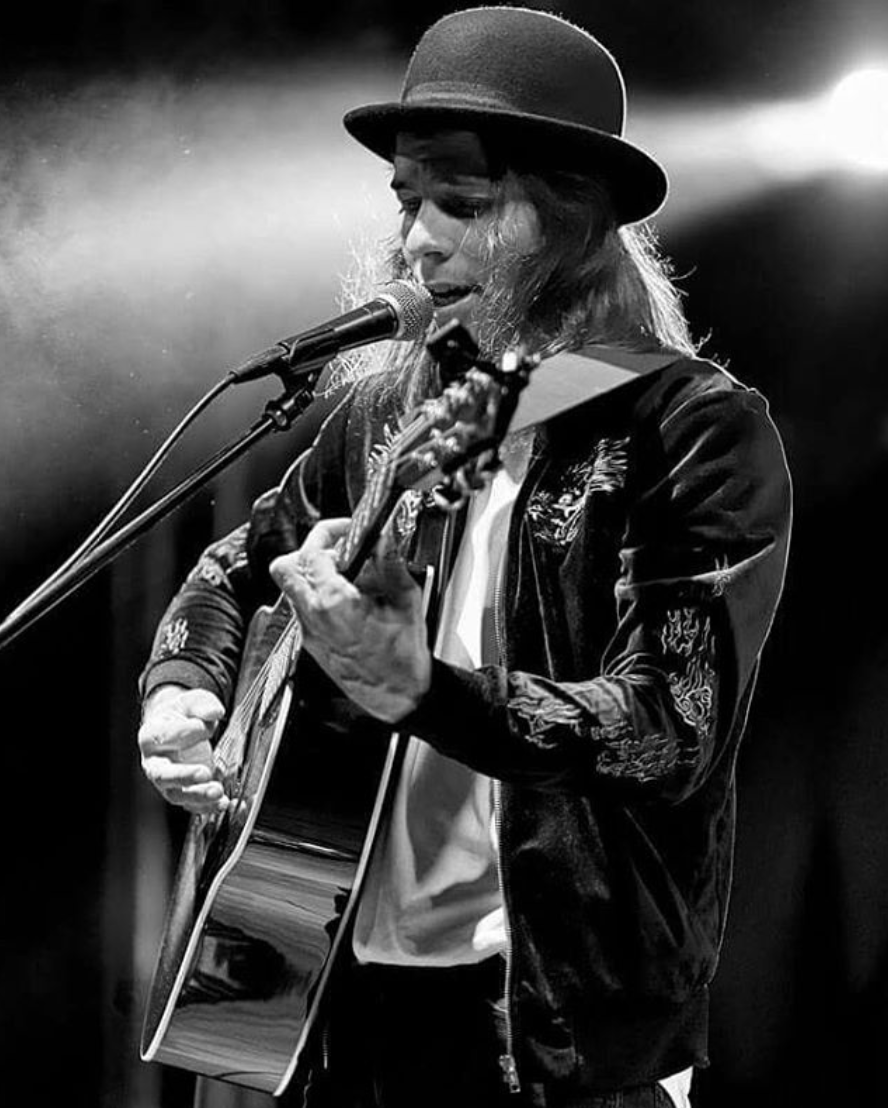 Music artist FRANK singing on stage