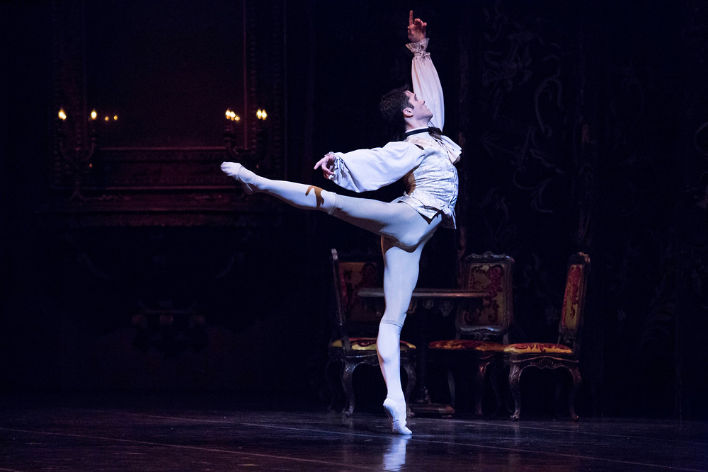 Dancer Claudio Coviello performing a dance move during a ballet