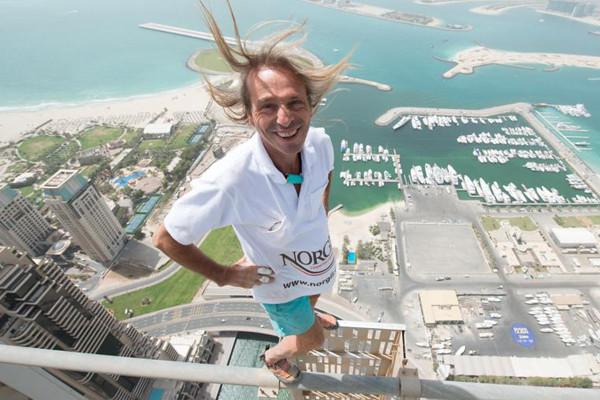 Alain Robert on top of a skyscraper