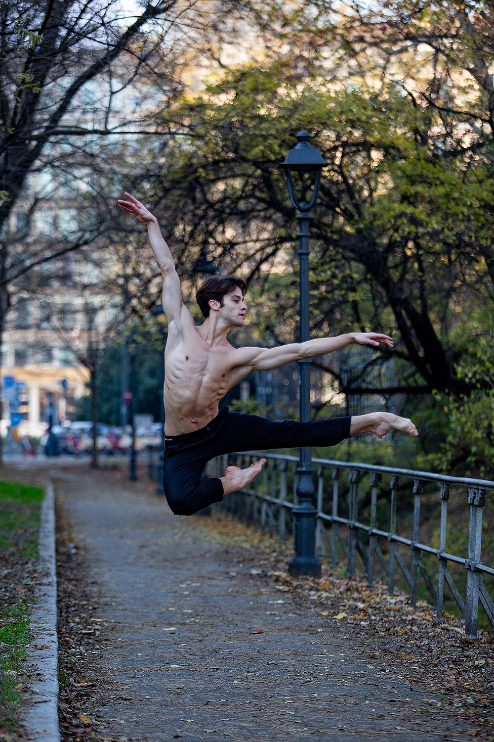 Dancer Claudio Coviello performing a dance move out in the street