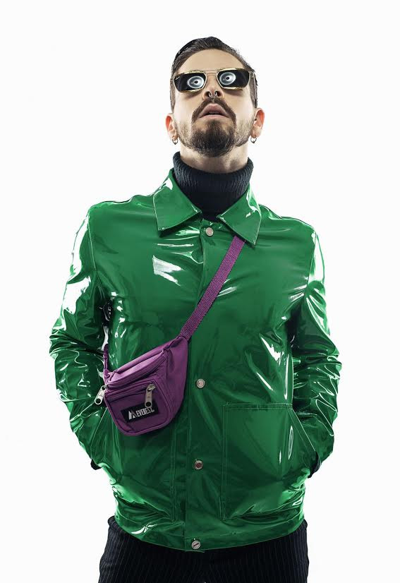 Dancer Mattia Tuzzolino wearing a green jacket and a purple pouch