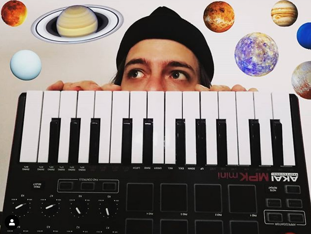 Music artist FRANK with a keyboard