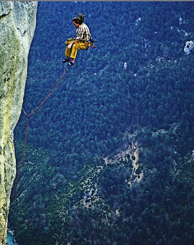 Alain Robert while climbing a mountain