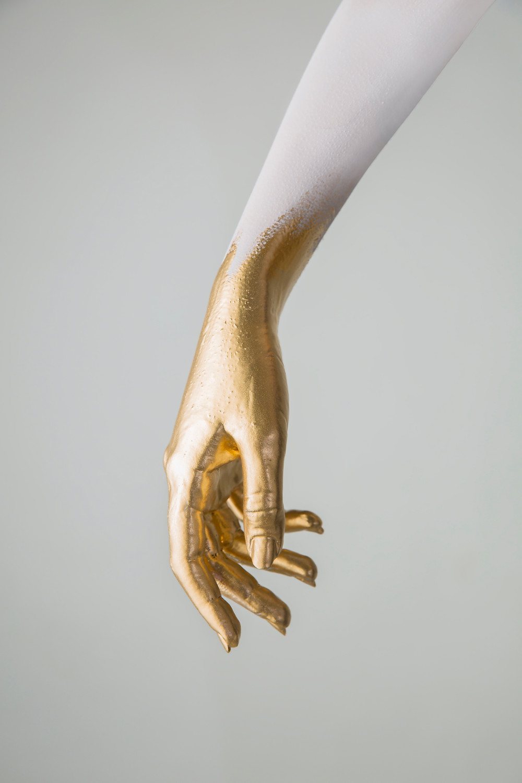 Photographer Lara Zankoul artistic shot of a gold hand