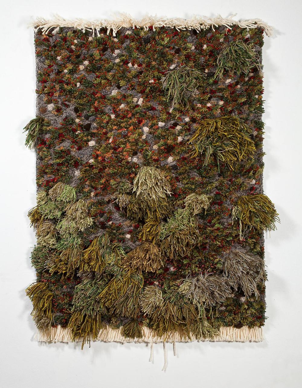Artist Alexandra Kehayoglou's rug representing grass and dirt