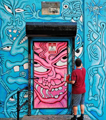 American artist Andy Golub working on a mural in Long Island