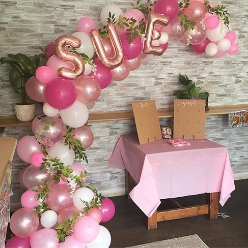 A personalised half balloon arch