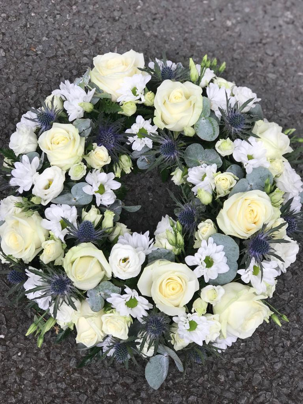 blue and white funeral flowers wreath ch