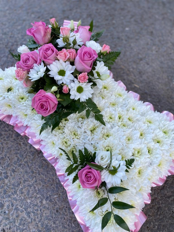 Pink and white based, traditional funeral tribute