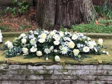 white casket spray, funeral flowers chobham florist.jpg