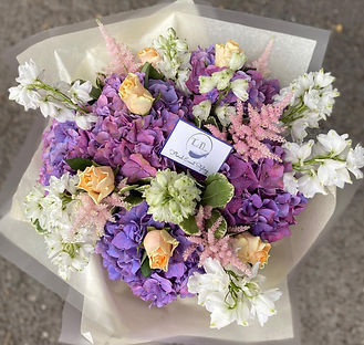 Lilac, peach and pink handtied bouquet f