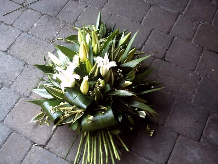 lilly sheaf spray funeral flowers. chobham woking surrey