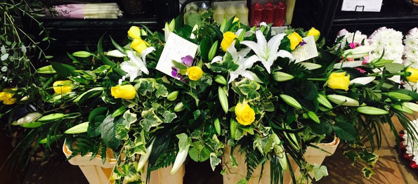 yellow rose and lilly casket