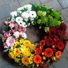 large rainbow wreath tribute flowers. chobham surrey, uk