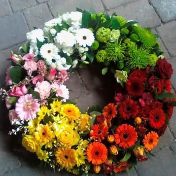 large rainbow wreath tribute flowers. chobham surrey, uk