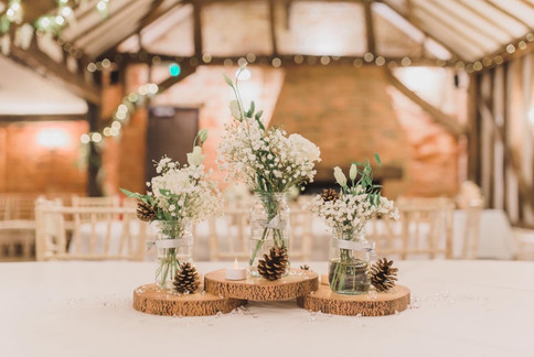 simple jars and wood slice table centres