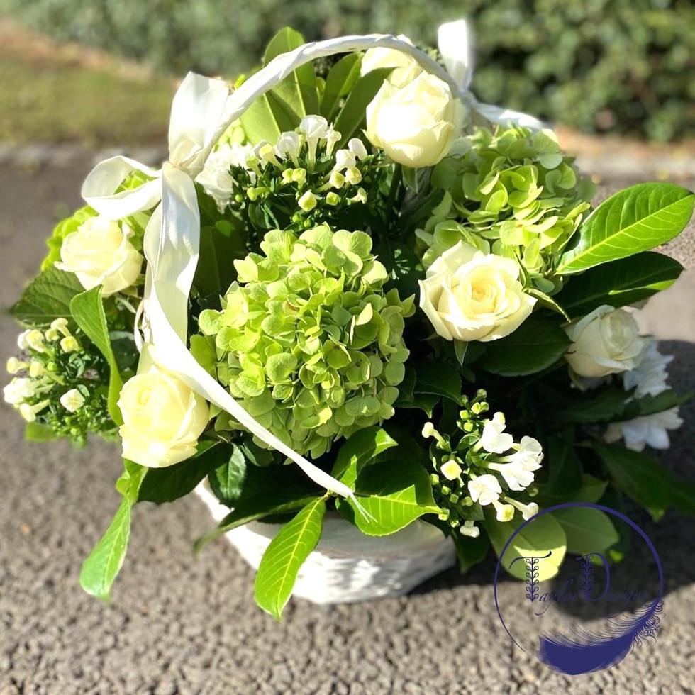whire and gree basket arrangment. Funeral flowers by taylor designs, chobham, woking, surr