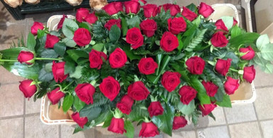 red rose casket spray, funeral flowers, florist chobham, surrey