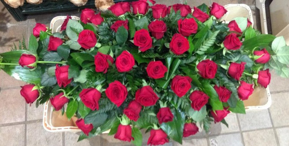 red rose casket spray, funeral flowers, florist chobham, surrey
