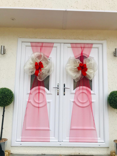 double red and gold door bow