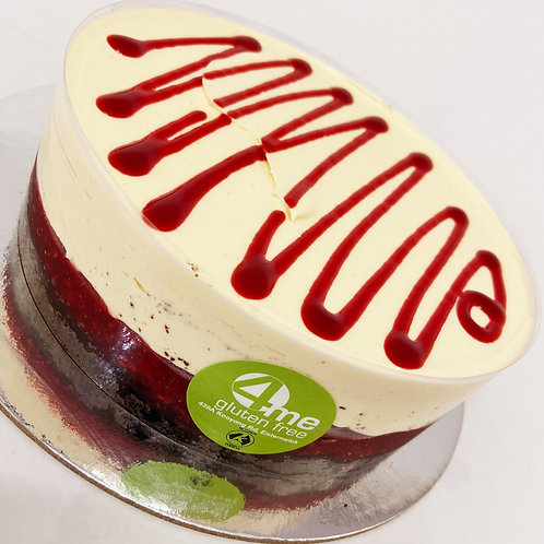 white chocolate mousse cake with a raspberry coulis & chocolate sponge base 7in